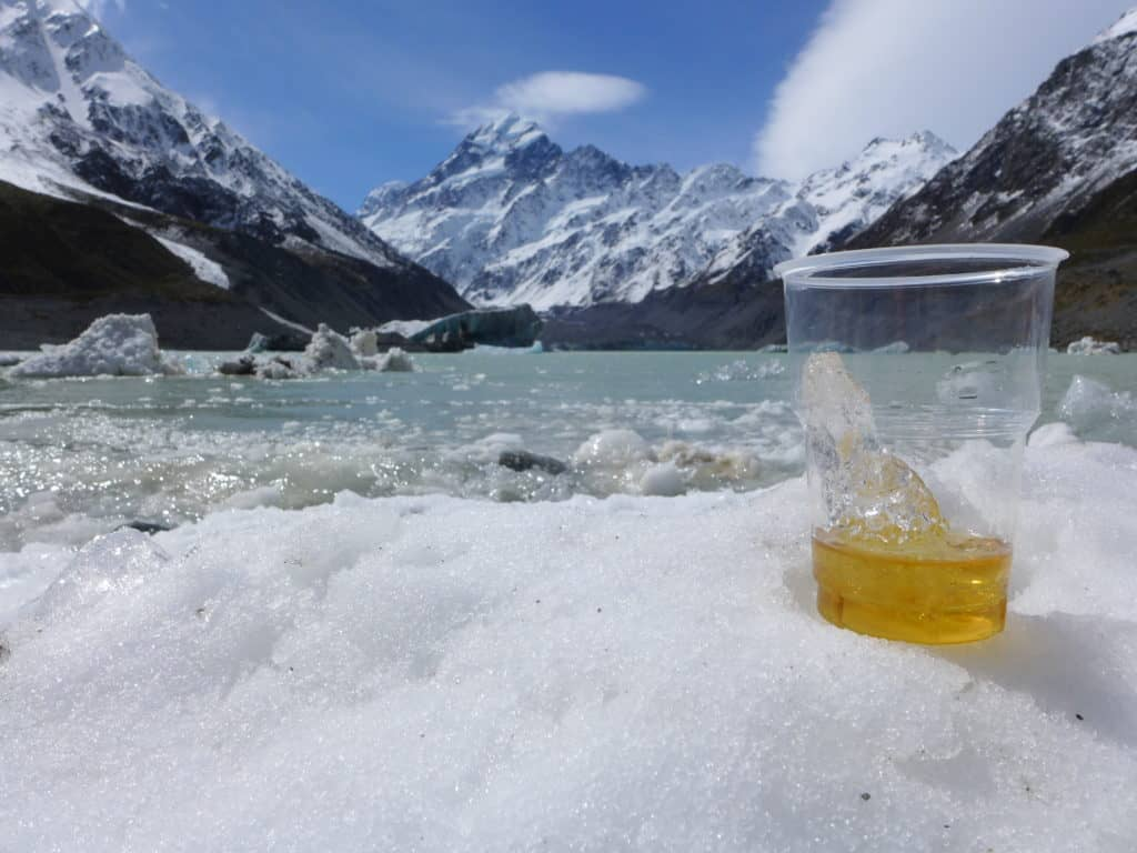 A cocktail and a view of the Hooker Valley Glacier, on the Hooker Valley track