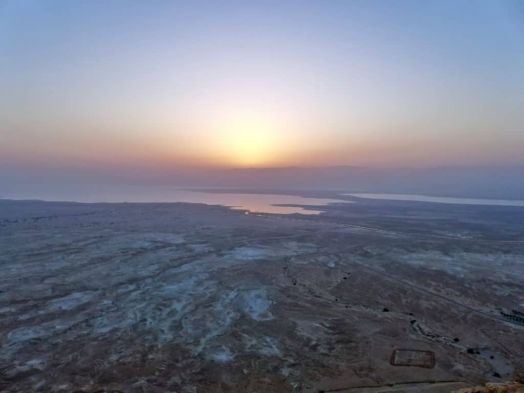 A 3am wake-up call is totally worth it for this sunrise view from Masada over the Dead Sea. Add it to your Israel itinerary, tips for visiting.