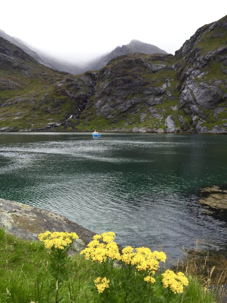 Get off the beaten path in the Isle of Skye and take a boat trip from Elgol to Loch Coruisk. Backed by the moody Black Cuillins & very remote, there's beautiful wildlife and stunning untouched nature! Planning a trip to Isle of Skye, Scotland itinerary tips! #scotland #isleofskye