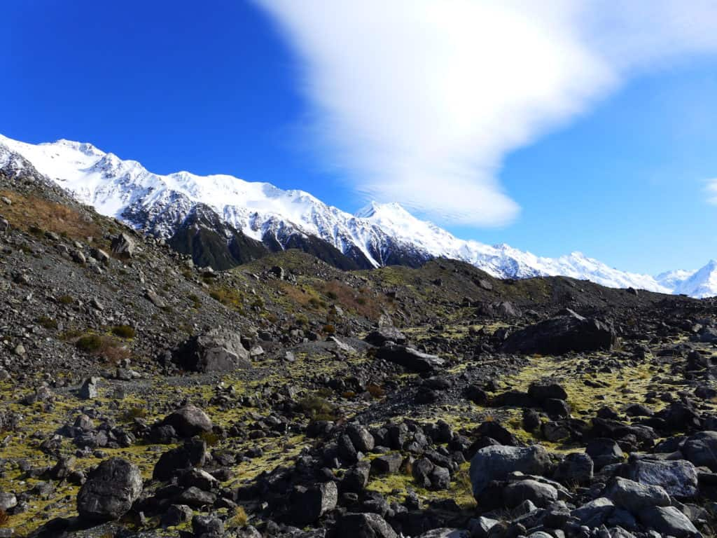 A glacier lake boat tour is a must in New Zealand, why you have to visit Tasman Lake on the South Island. New Zealand itinerary advice & trip planning, what to do near Lake Tekapo or Mt. Cook in New Zealand #newzealand #glacier
