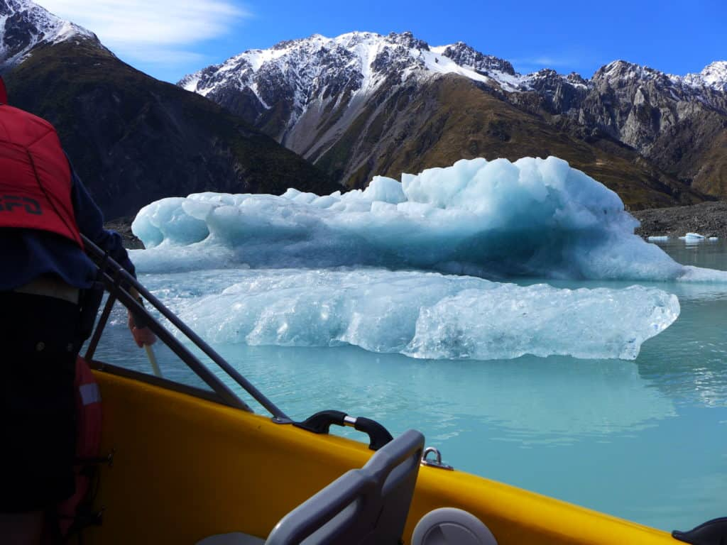 Why a glacier lake boat tour is a must in New Zealand, tips for visiting Tasman Lake on the South Island. New Zealand itinerary advice & trip planning, what to do near Lake Tekapo or Mt. Cook in New Zealand #newzealand #glacier