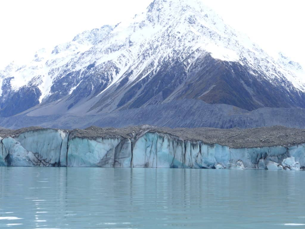 Tasman Glacier, New Zealand...a glacier lake boat tour is a must in New Zealand, why you have to visit Lake Tasman on the South Island. New Zealand itinerary advice & trip planning, what to do near Lake Tekapo or Mt. Cook in New Zealand #newzealand #glacier