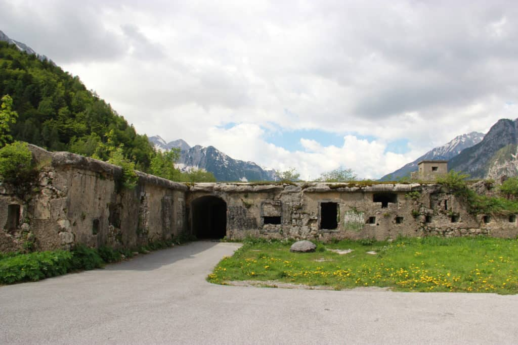A WWI bunker in the Julian Alps | Some of the worst WWI fighting happened in these mountains, so there's tons of history in addition to the gorgeous turquoise water and craggy mountain peaks. Make sure your Slovenia itinerary includes a drive through the Julian Alps! The Julian Alps combine Slovenia's most amazing natural beauty with tons of WWI history, & are an easy day trip from Ljubljana or a great way to get between destinations. From the Vrsic Pass to the Soca River, this is a must on any Slovenia trip | What to do in Slovenia, trip planning tips for #Slovenia #traveltips #itinerary