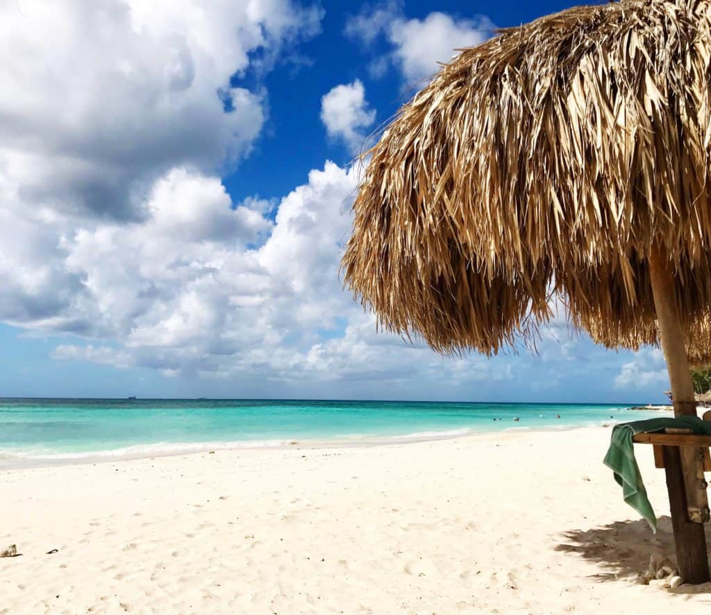 All Aruba beaches are public property, which means even a hotel's palapa is up for grabs | 10 Aruba facts to help you plan your trip...from its dry, windy climate (making for great water sports), location outside the hurricane belt, to amazing food and culture, Aruba is the perfect Caribbean island to visit! #aruba #caribbean #beach