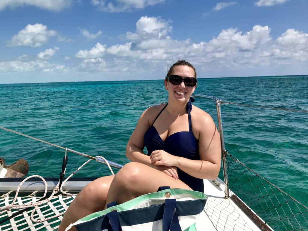 Swimming with nurse sharks on a super chill day snorkeling & sailing with Carlos Tours in Caye Caulker, Belize | Belize has the second-largest barrier reef in the world and amazing diving & snorkeling! What to do for a chill vacation in #cayecaulker #belize