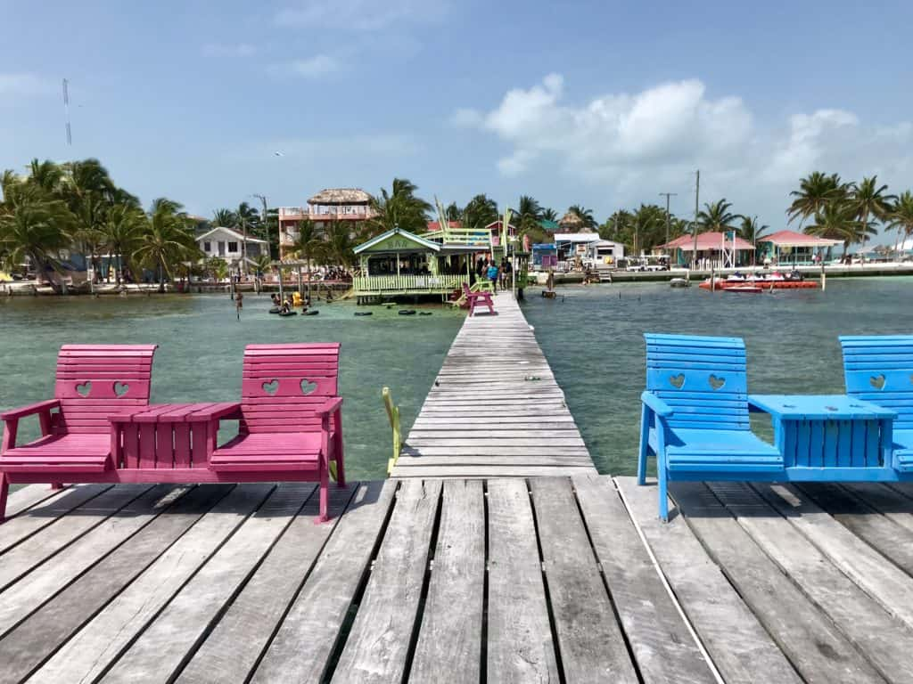 Pull up a swing or chair at the Sip N Dip in Caye Caulker for a chill afternoon