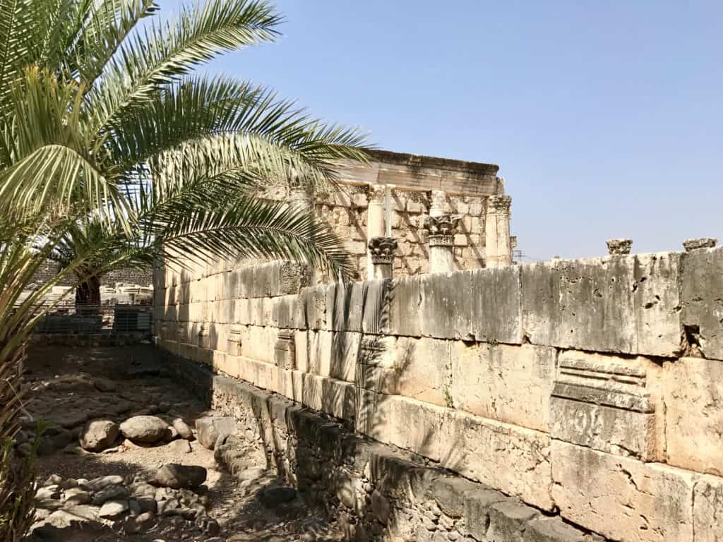 The white synagogue at Capernaum | A day trip from Tel Aviv to northern Israel, covering Caesarea, Tel-Megiddo, the Sea of Galilee, Capernaum, the Mount of Beatitudes, Tiberias, and Akko | what to do in Israel | There's so much to visit in such a small area, you can have a jam-packed day driving from Tel Aviv or Jerusalem but cover so many historic sites and towns | Israel itinerary ideas, Christian history trips, visit the Jesus trail, bible archaeology tours, what to see in Israel, Jerusalem day trips #israel #seaofgalilee #telaviv