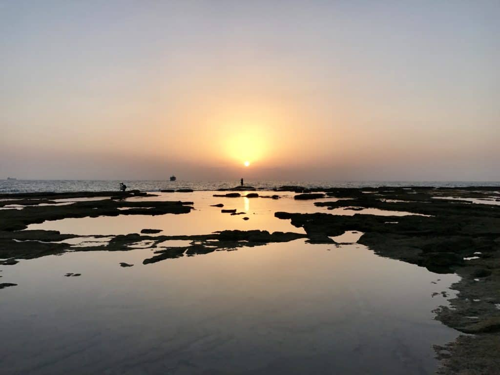 Sunset in Akko or Acre | A day trip from Tel Aviv to northern Israel, covering Caesarea, Tel-Megiddo, the Sea of Galilee, Capernaum, the Mount of Beatitudes, Tiberias, and Akko | what to do in Israel | There's so much to visit in such a small area, you can have a jam-packed day driving from Tel Aviv or Jerusalem but cover so many historic sites and towns | Israel itinerary ideas, Christian history trips, visit the Jesus trail, bible archaeology tours, what to see in Israel, Jerusalem day trips #israel #seaofgalilee #telaviv