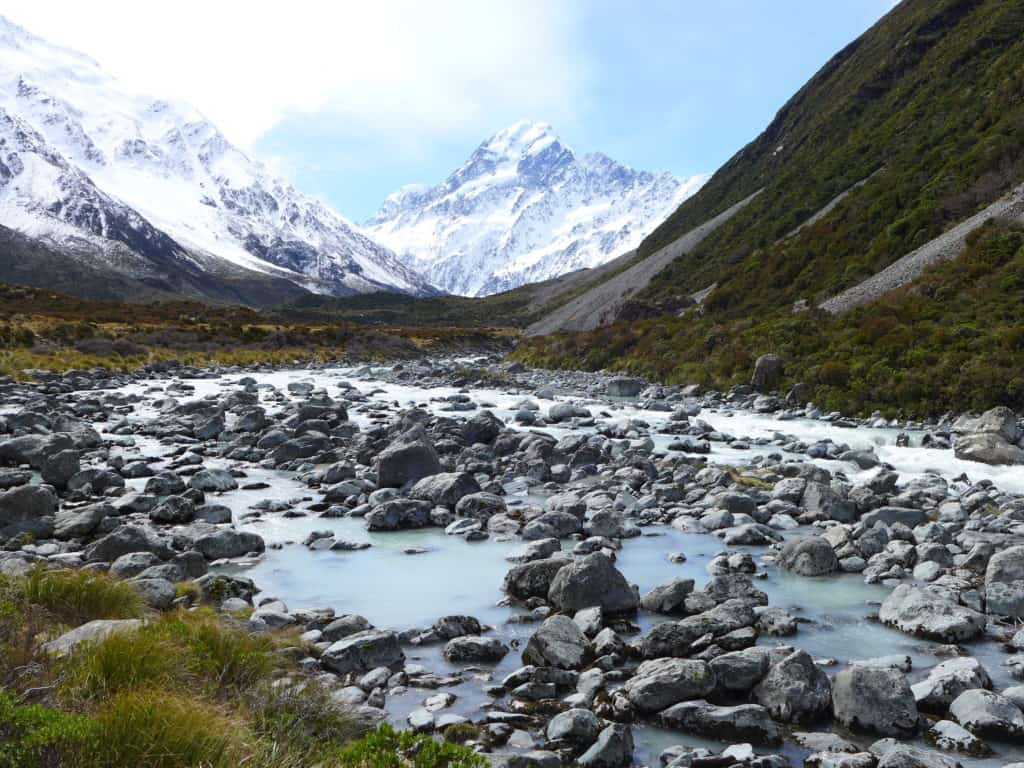 The Hooker Valley track offers snow-capped peaks, milky waters, and a glacier lake