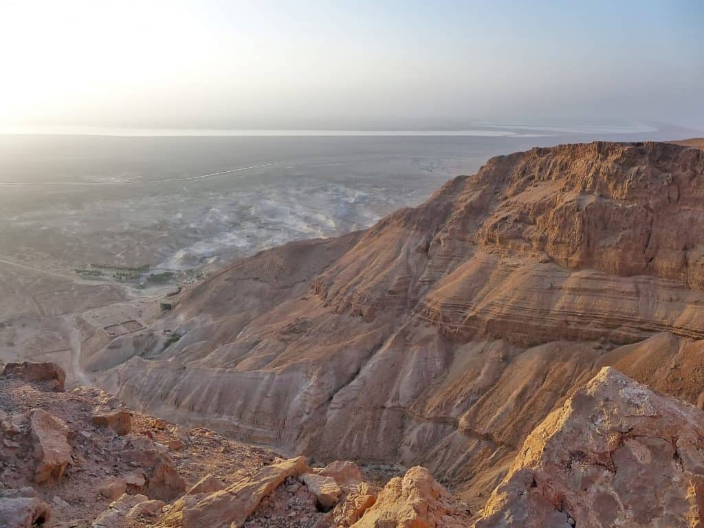 Why hiking Masada at sunrise is a must if you're in Israel...climb the Snake Path for breathtaking views of the Dead Sea. Tips for finding a tour, what to wear and bring, how to make the most of this experience.