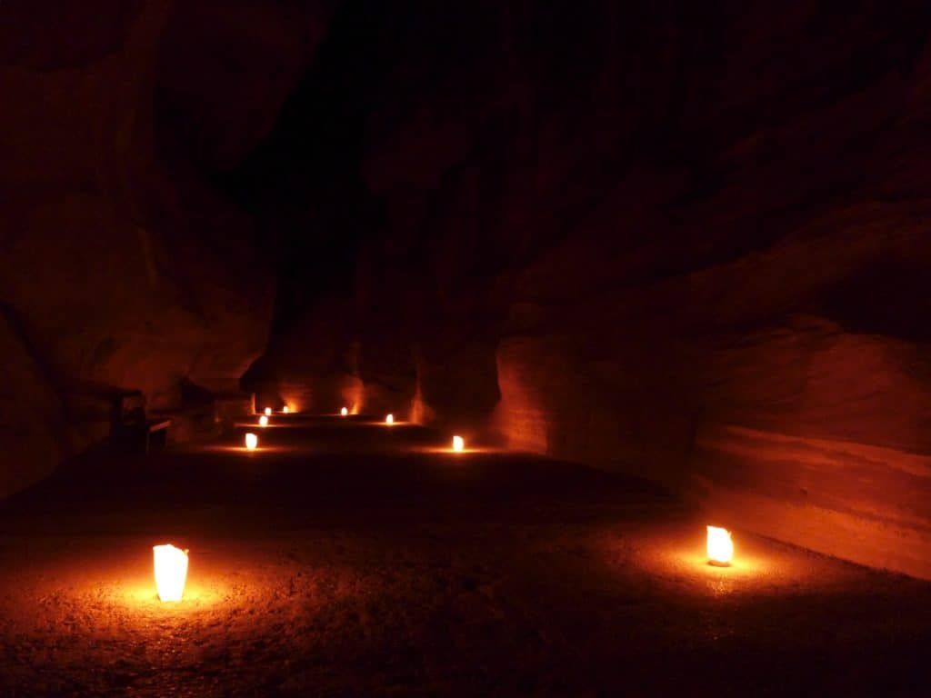 Petra's Siq lit up with lanterns | Mesmerizing Petra by Night is a can't-miss experience when visiting Jordan | Tips for seeing Petra at Night, one of the Seven Wonders of the World | Lost City of Petra at night, Wadi Musa, Jordan #jordan