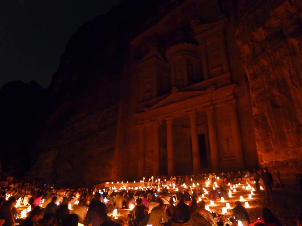 Mesmerizing Petra by Night is a can't-miss experience when visiting Jordan | Tips for seeing Petra at Night, one of the Seven Wonders of the World | Lost City of Petra at night, Wadi Musa, Jordan #jordan
