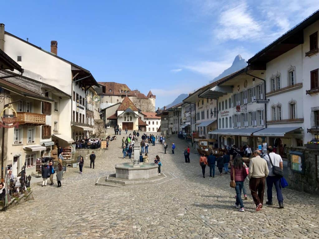 Gruyeres is more than cheese--but it is part of the appeal! Voted Switzerland's most beautiful town, ideas for your visit, how to plan a trip...it's an easy day trip from Geneva!