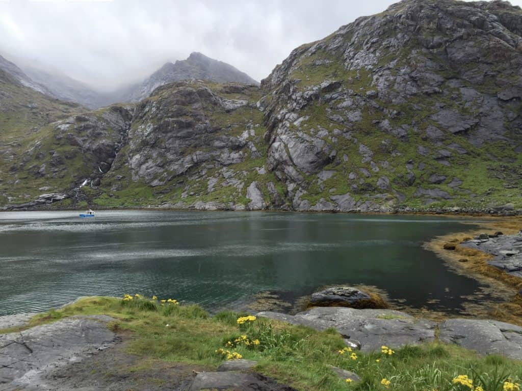 Boat Trip on Isle of Skye, Scotland UK   One itinerary idea on the Isle of Skye is to take a boat trip from Elgol to Loch Coruisk. Backed by the moody Black Cuillins & very remote, there's beautiful wildlife and stunning untouched nature! Planning a trip to Skye, Scotland itinerary tips! #scotland #isleofskye #boats