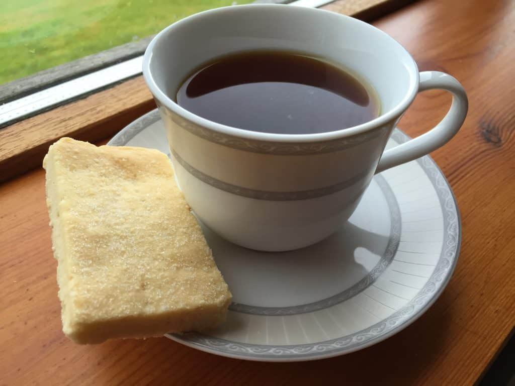 Hot tea and shortbread at a B&B in Isleornay after a boat trip to Loch Coruisk. There's so much to do on the Isle of Skye, ideas for planning your trip and itinerary advice. #scotland #isleofskye