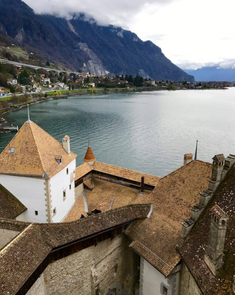 Views of Lake Geneva from Chateau Chillon | Switzerland's Chateau Chillon and tiny medieval Yvoire, France are a perfect day trip from Geneva | how to plan your trip, how to visit Chateau Chillon, day trips from Geneva, what to do in Geneva, Switzerland trip planning tips #chateauchillon #yvoire #geneva #switzerland