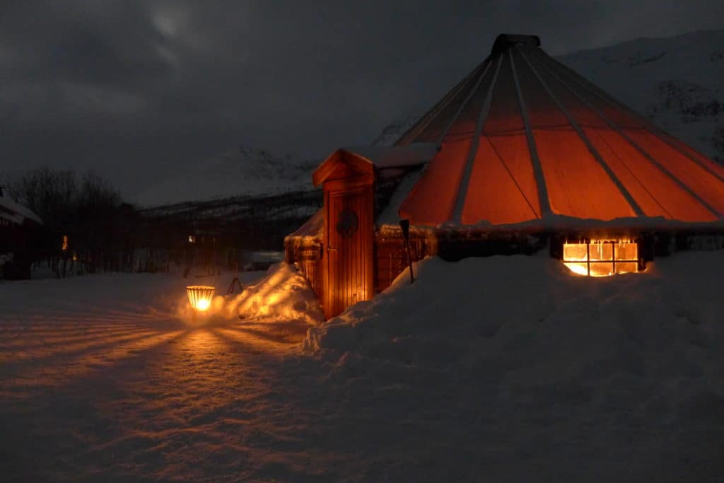 Cozy Sami tent evenings at Camp Tamok | We went dog sledding & slept in a traditional Sami lavvu tent, ate delicious food & soaked in stunning views | What to do in Tromso, sleeping in a Sami tent, Arctic adventures, mushing, dog sledding in Norway, what to do in Norway #tromso #norway #lyngsfjord #camptamok