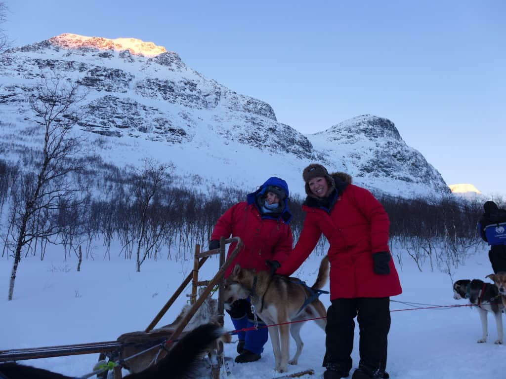 Dog sledding in Tromso, Norway | Why it's a must and how to plan your trip, what to do in Tromso, what to do in Norway | Tromso is 200 miles north of the Arctic Circle & perfect to visit for the Northern Lights and more! #dogsledding #tromso #norway