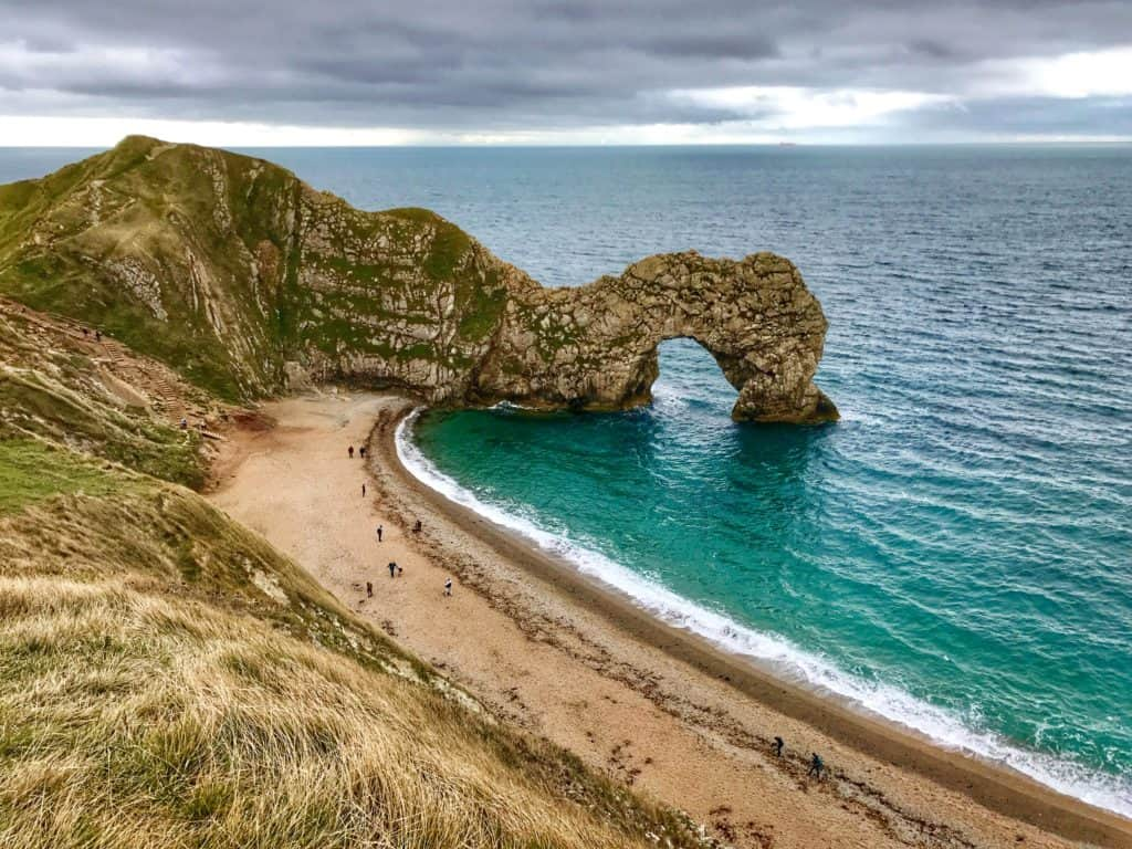 How to visit the Durdle Door, on England's Jurassic Coast | the Durdle Door, Corfe Castle, Lyme Regis, & a stop at Exeter Cathedral | how to visit the Durdle Door, where to go on the Jurassic Coast in England, England's Jurassic Coast | what to do in England, UK road trip ideas, natural beauty in England, road trip in England #jurassiccoast #england #uk #durdledoor