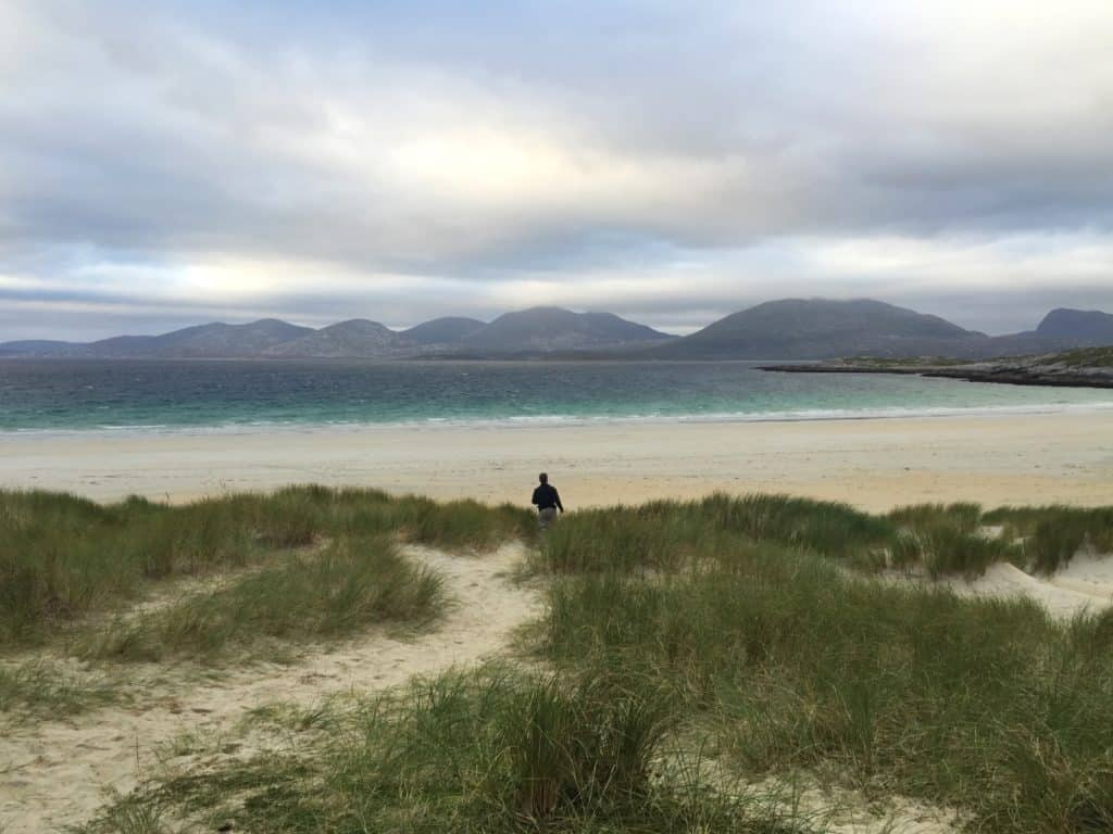 Luskentyre Beach on Scotland's mystical Isle of Lewis and Harris | this gorgeous island is full of history, amazing scenery, culture, great food, wildlife, and more. Make sure a trip to the Isle of Harris & Lewis is on your Scotland itinerary, how to plan your trip to the Isle of Harris & Lewis, Callanish standing stones, Luskentyre Beach, & more! #scotland #islelewisharris #highlandsandislands #scottishisles