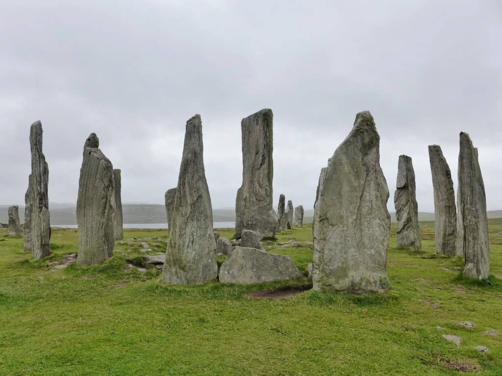 The amazing Callanish standing stones on Scotland's mystical Isle of Lewis and Harris | this gorgeous island is full of history, amazing scenery, culture, great food, wildlife, and more. Make sure a trip to the Isle of Harris & Lewis is on your Scotland itinerary, how to plan your trip to the Isle of Harris & Lewis, Callanish standing stones, Luskentyre Beach, & more! #scotland #islelewisharris #highlandsandislands #scottishisles