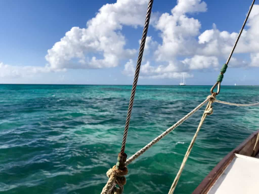 Sailing and other water sports are a must in Aruba | 10 things you should know about to help you plan your trip...from its dry, windy climate (making for great water sports), location outside the hurricane belt, to amazing food and culture, Aruba is the perfect Caribbean island to visit! #aruba #caribbean #beach