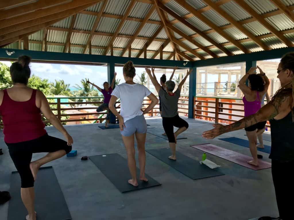 Rooftop yoga in Caye Caulker, Belize | how to have a chill vacation in Belize, things to do in Caye Caulker