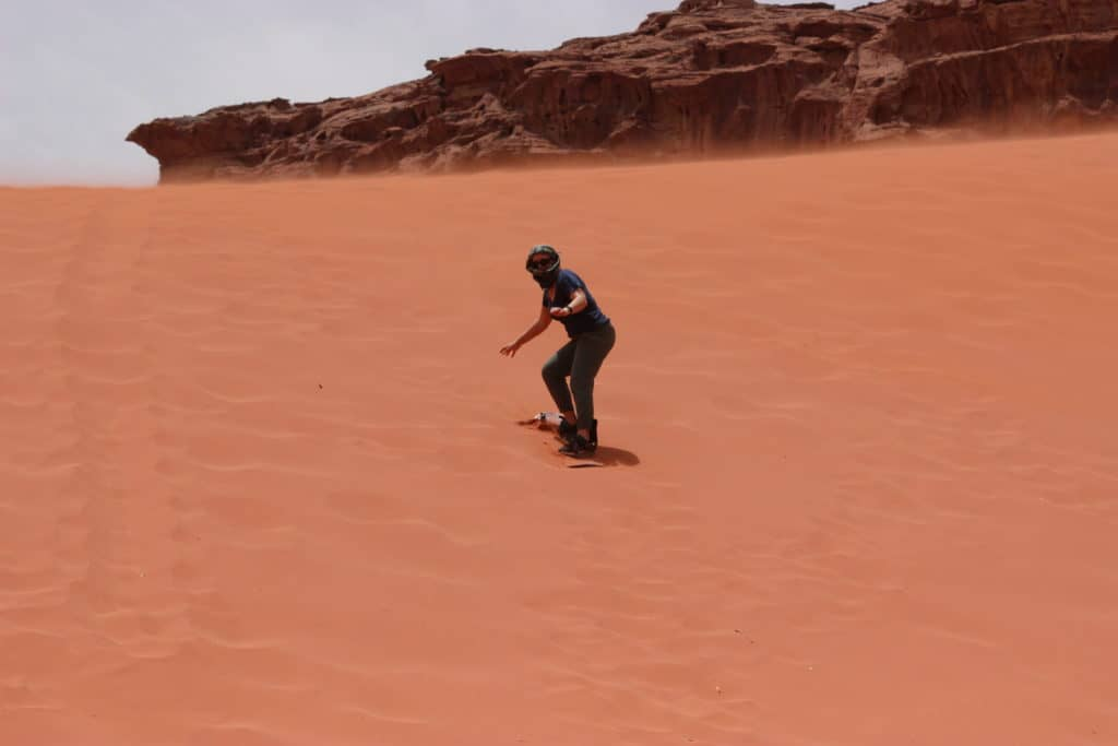 Sandboarding in Wadi Rum...coasting down the red dunes in Jordan!