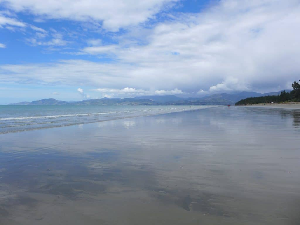 Mirror-like beach near Nelson New Zealand