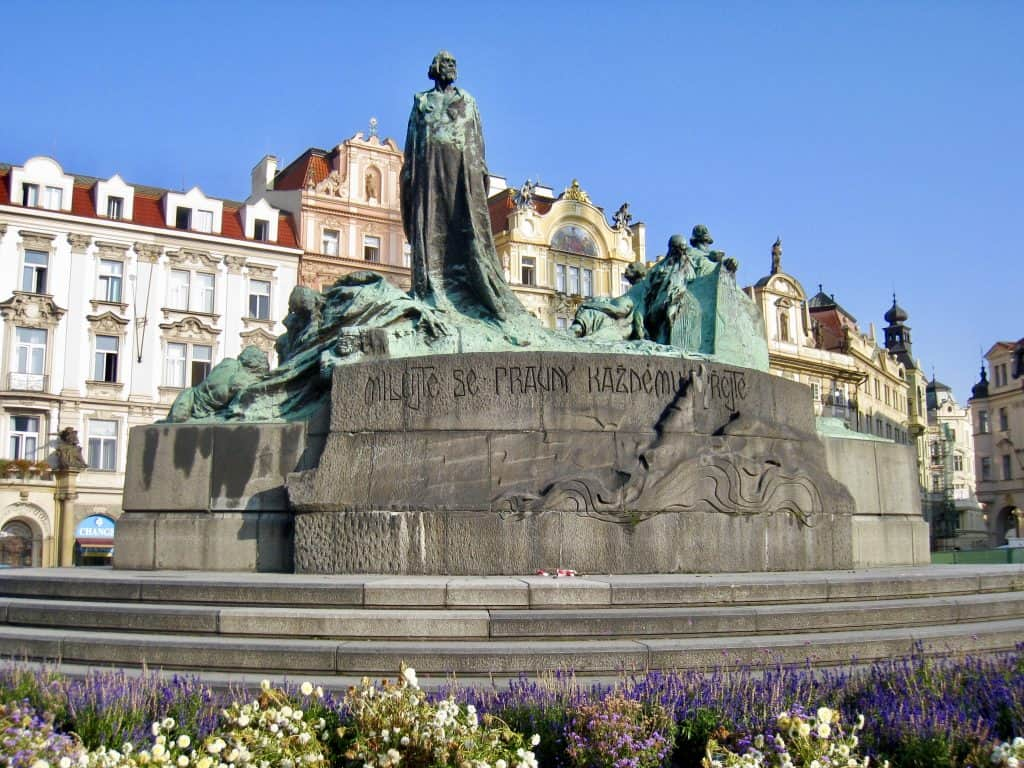 The statue of Jan Hus in Prague's Old Town Square | commemorating religious and historical conflicts in the Czech Republic