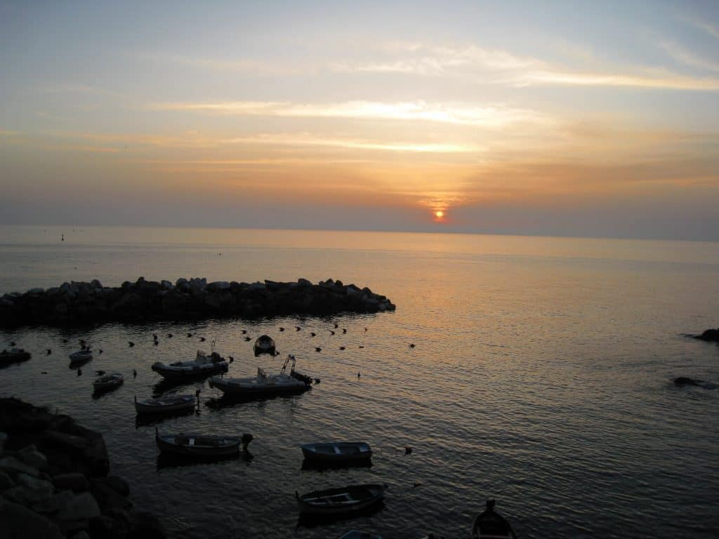 Riomaggiore at sunset...where to watch the sunset in Cinque Terre | One Girl, Whole World