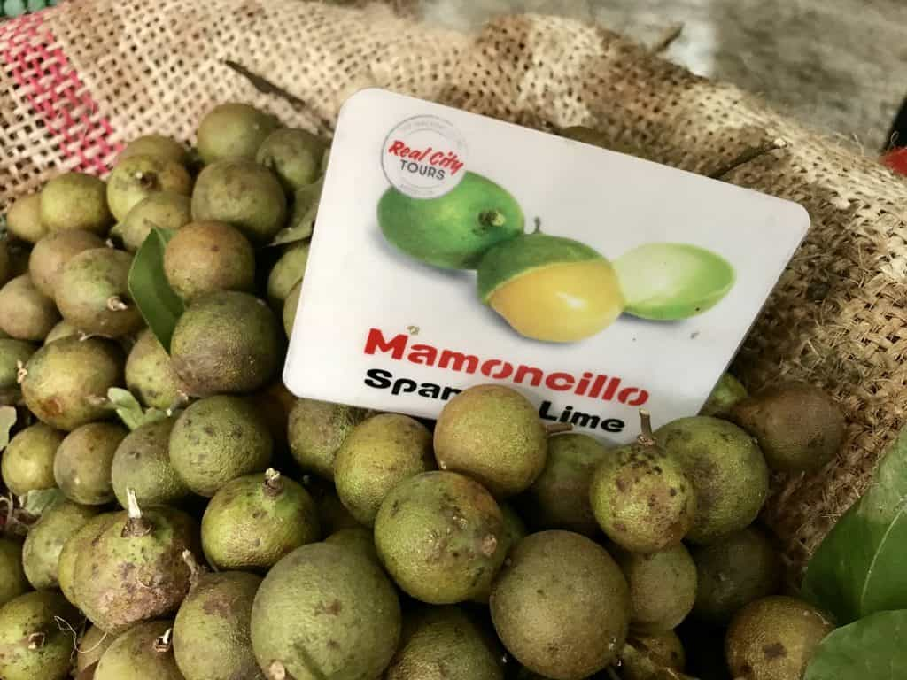 Taking an exotic fruit tour in Medellin, Colombia | One Girl, Whole World...mamoncillo are like a tart, delicious, weird eyeball that will numb your mouth if you have too many