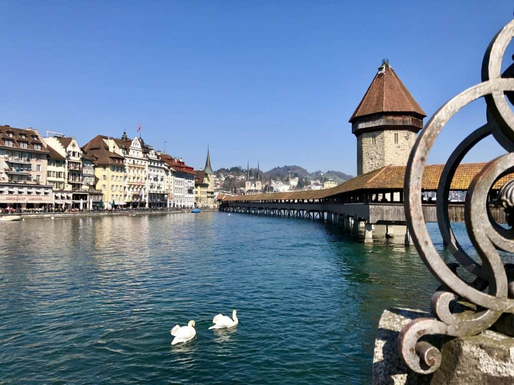 Kappelbrucke, in Lucerne, Switzerland | Lucerne (or Luzern) is a charming medieval town in central Switzerland, a perfect base for visiting Mt. Rigi or Mt. Pilatus, and enjoying the famous Kappelbrucke and Lion of Lucerne. What to do in Lucerne, Switzerland itinerary ideas!