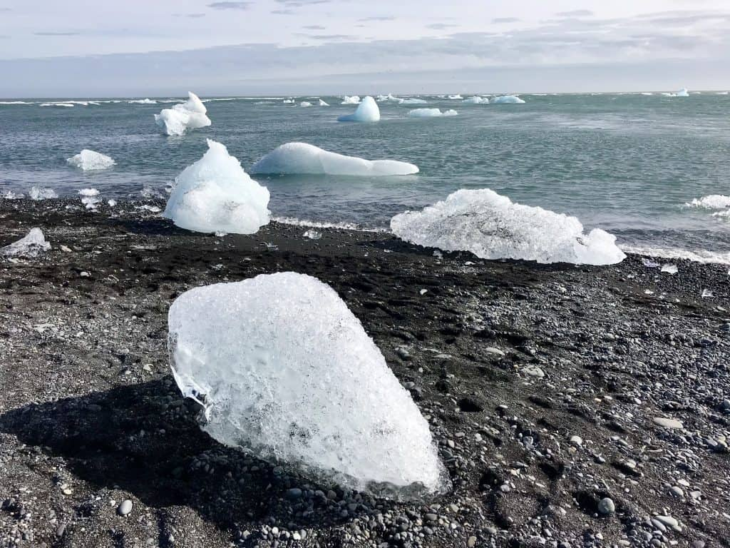 "Visiting Iceland's Famous Jökusárlón Glacier Lagoon & Diamond Beach | How to plan your visit to the glacier lagoon and black ""diamond"" beach, where to stay in Iceland, and other Iceland itinerary advice!"
