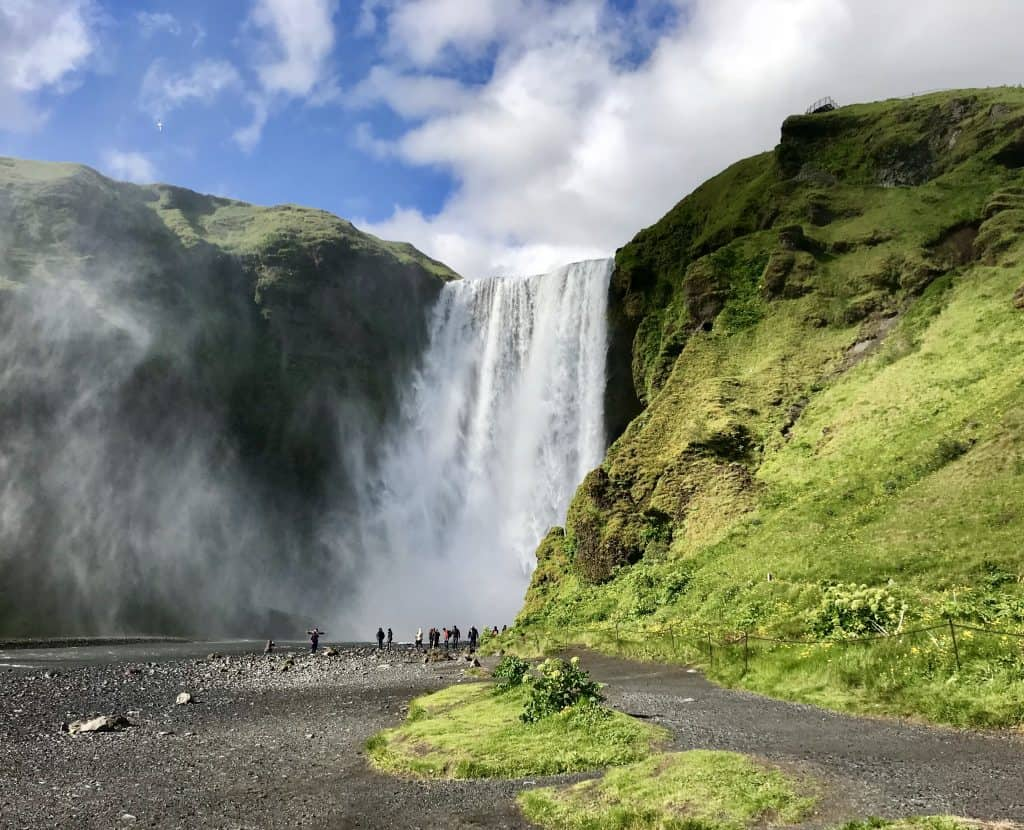 How To Visit Iceland's Skogafoss Waterfall | Tips for planning your visit to Skogafoss, how to get there, how long to spend, and what gear you need! Iceland itinerary ideas, Iceland roadtrip advice
