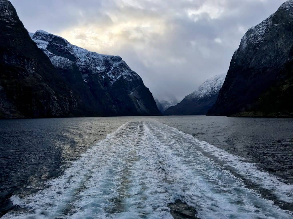 Beautiful trails in the water with the sun setting during winter - Norway in a Nutshell tour