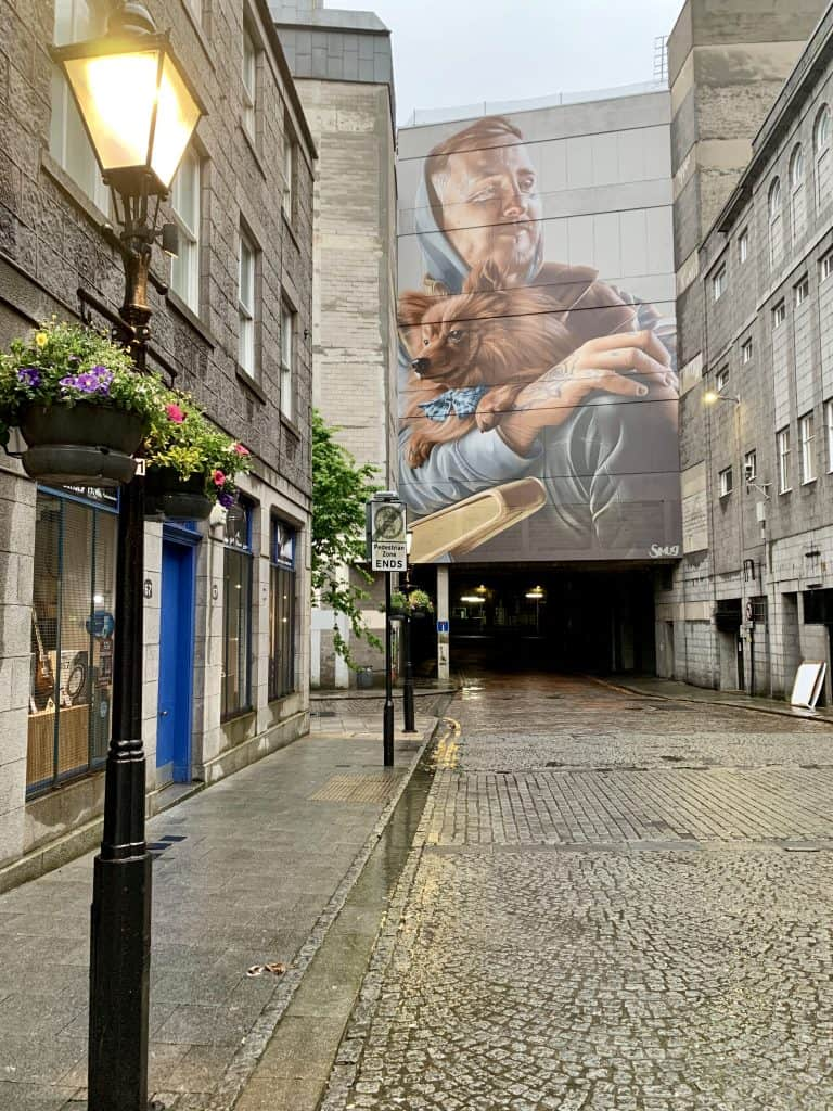 A dude and his dog, part of the Nuart street festival Aberdeen