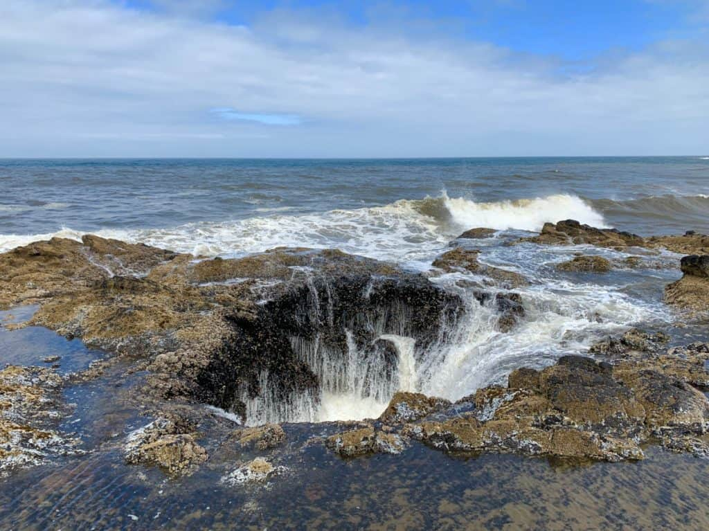 Watching Thor's Well in action, near Spouting Horn