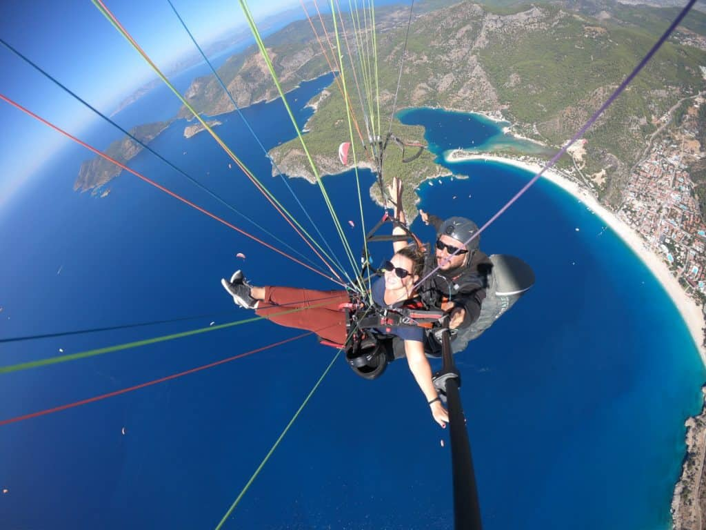 Floating over the sea while paragliding in Turkey