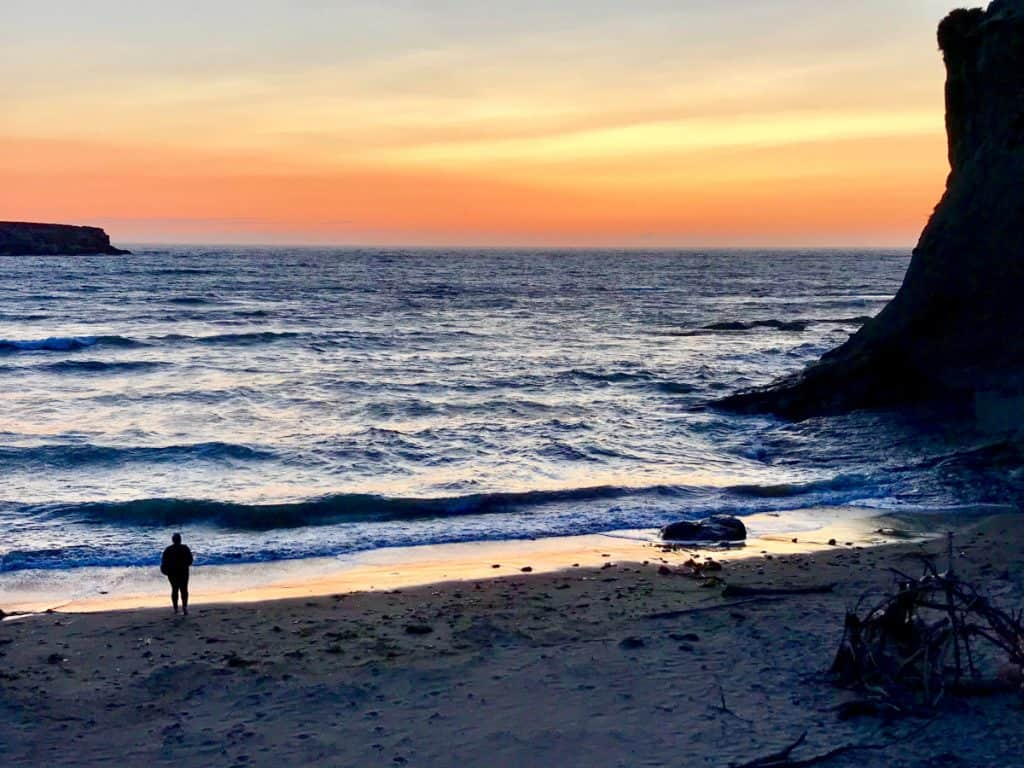 Watch the sun set over the Pacific Ocean - a must on an Oregon coast road trip itinerary