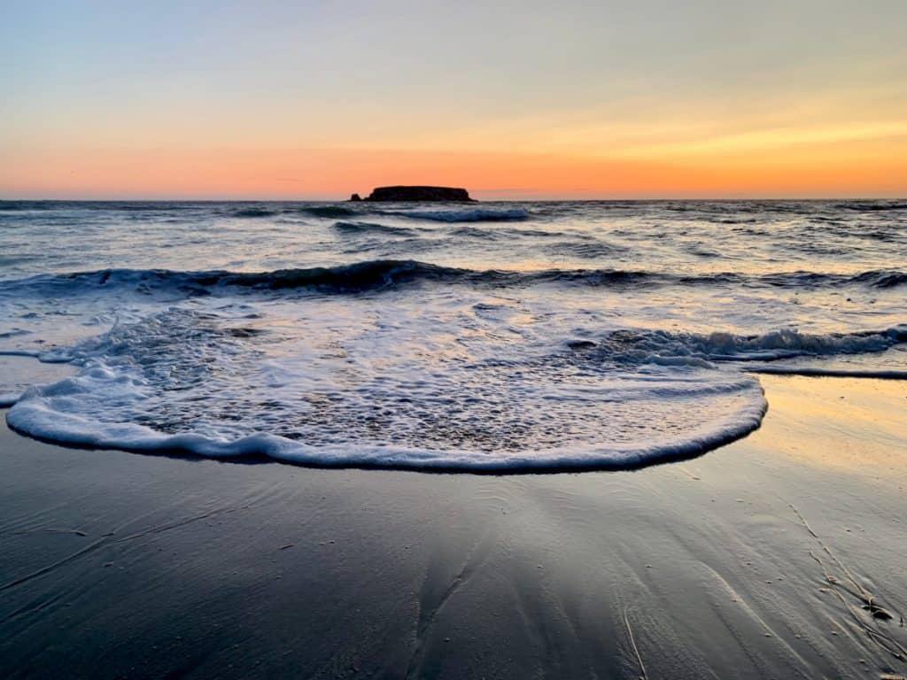 Enjoying the waves during an Oregon coast sunset