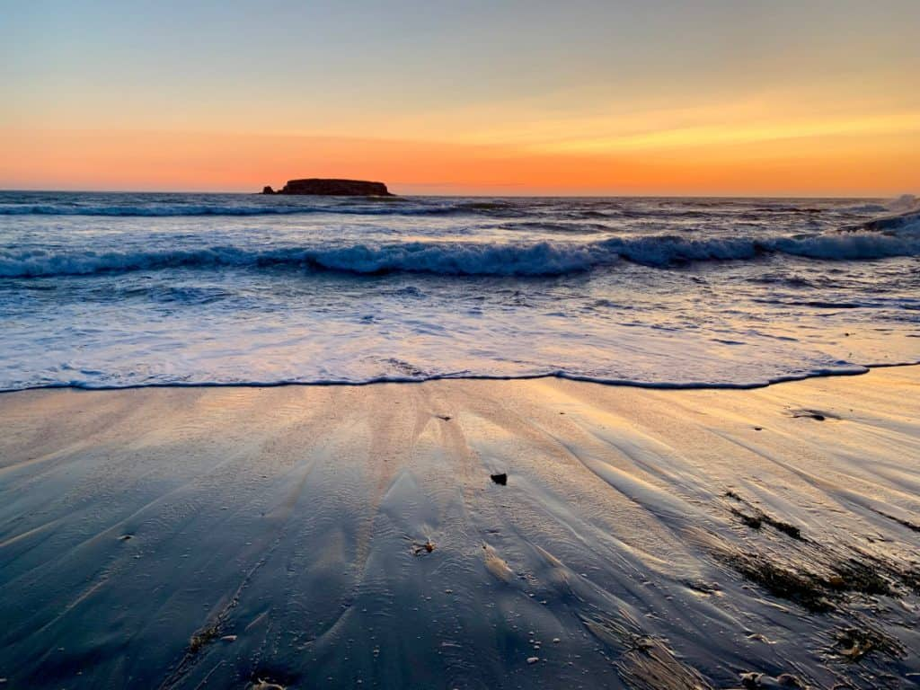 Gorgeous Oregon coast sunset - a must for any road trip itinerary