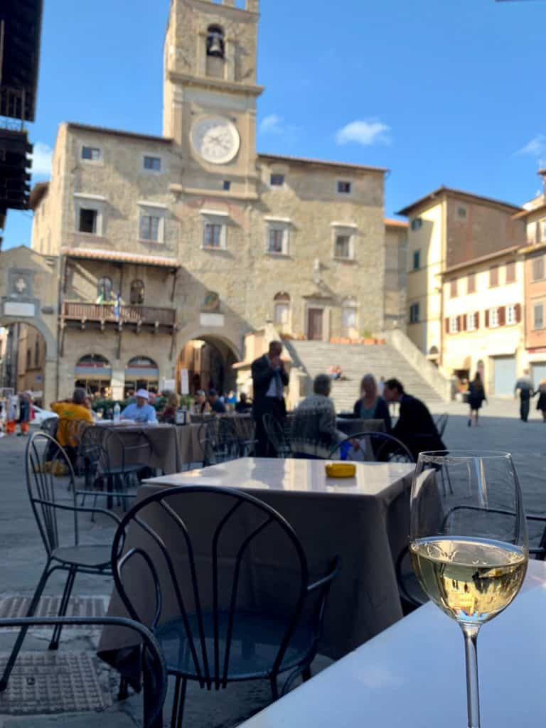 People watching in the Piazza della Republica in Cortona, Italy