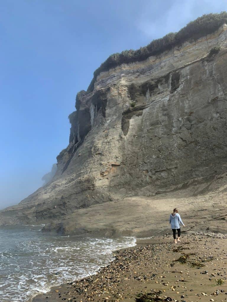 a foggy morning beach walk - a must on an Oregon coast road trip itinerary