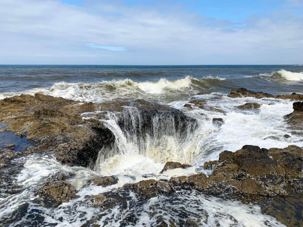 See Thor's Well spout and drain - a must on an Oregon coast road trip itinerary