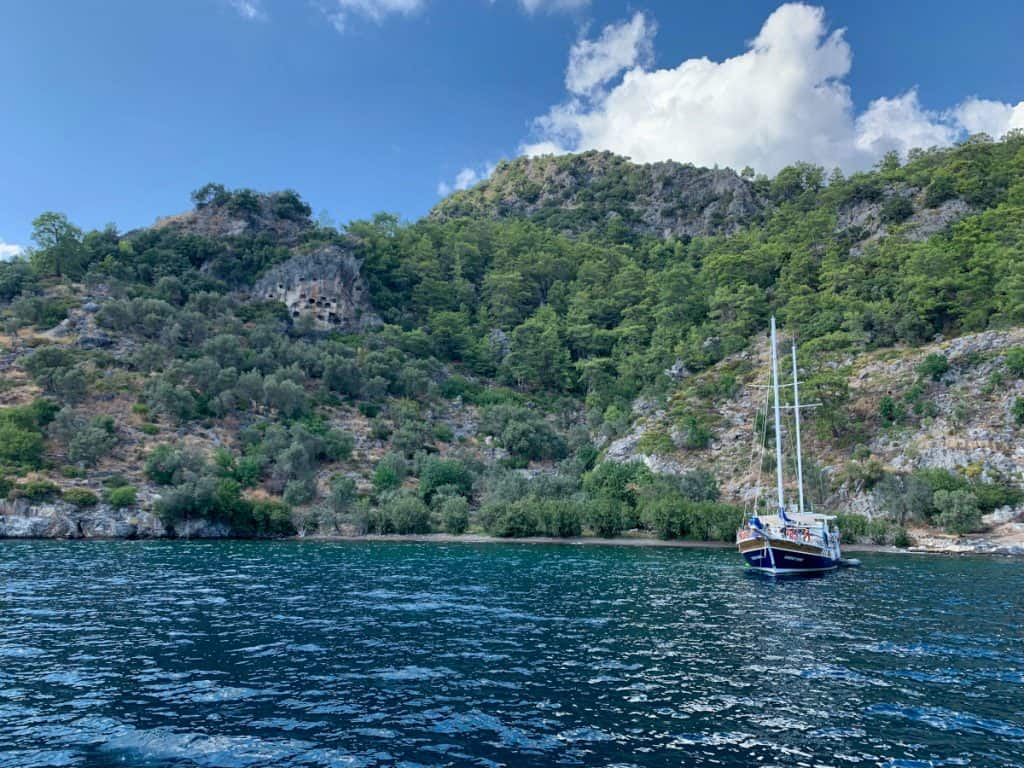 Lycian tomb ruins all over the cliffs - easy to see while sailing in Turkey