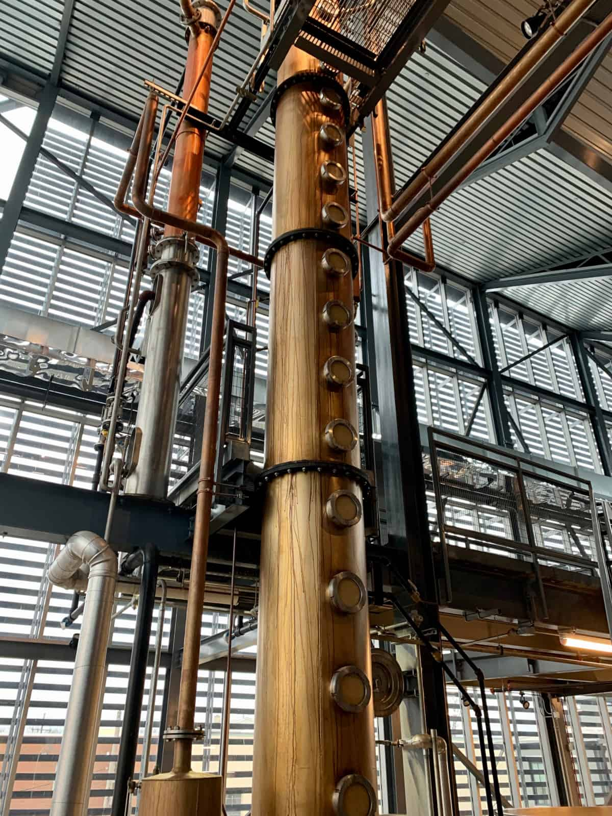 Touring Louisville's Rabbit Hole Distillery | Rabbit Hole is one of the most new and modern urban distilleries in the Louisville area. Here's what to expect on a visit, what it looks like inside, and why the rooftop bar is a must-visit. What to see on the Bourbon Trail or Urban Bourbon Trail, things to do in Louisville. #bourbon #bourbontrail #distillery #louisville #kentucky