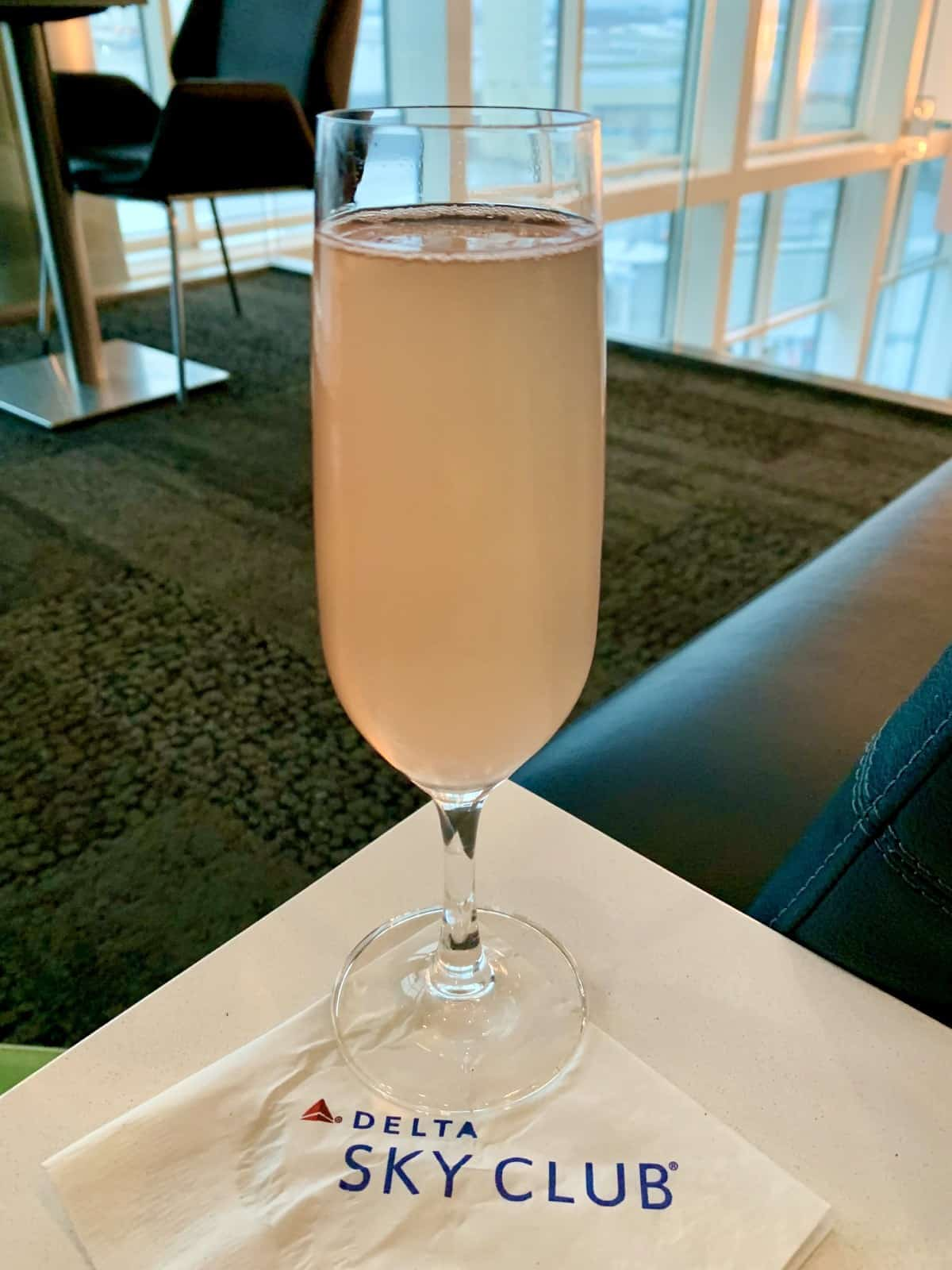 Champagne in the Delta Sky Lounge on delay...