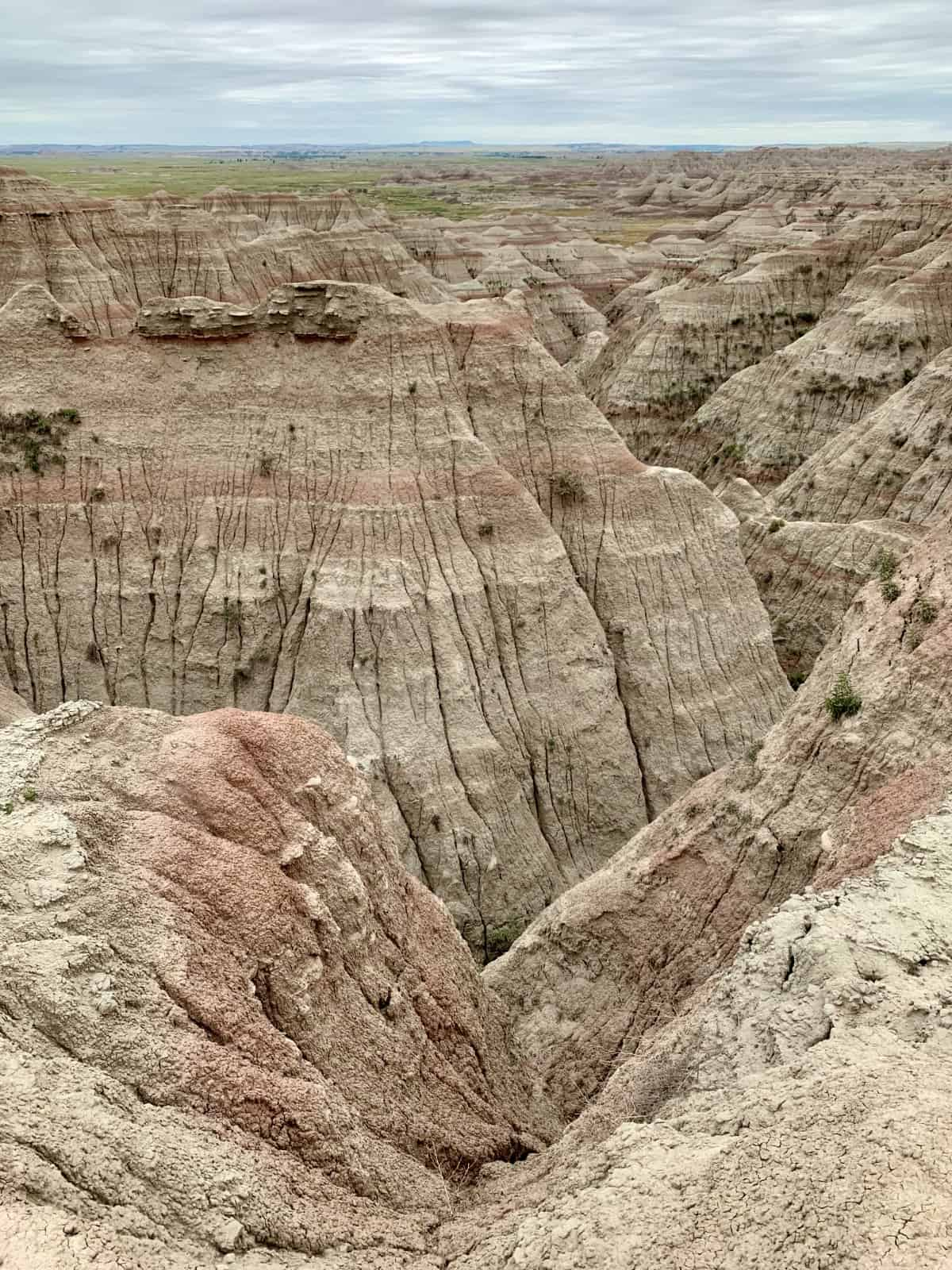 Planning a Trip to Badlands National Park | Why a roadtrip to South Dakota's Badlands is a must, and an easy day trip from Rapid City. What route to take, costs, things to do in Badlands, where to stop, and many more tips (including a stop at Wall Drug!). South Dakota roadtrip ideas, visiting national parks, social distance roadtrip ideas. #southdakota #nationalpark #nps #badlands #roadtrip