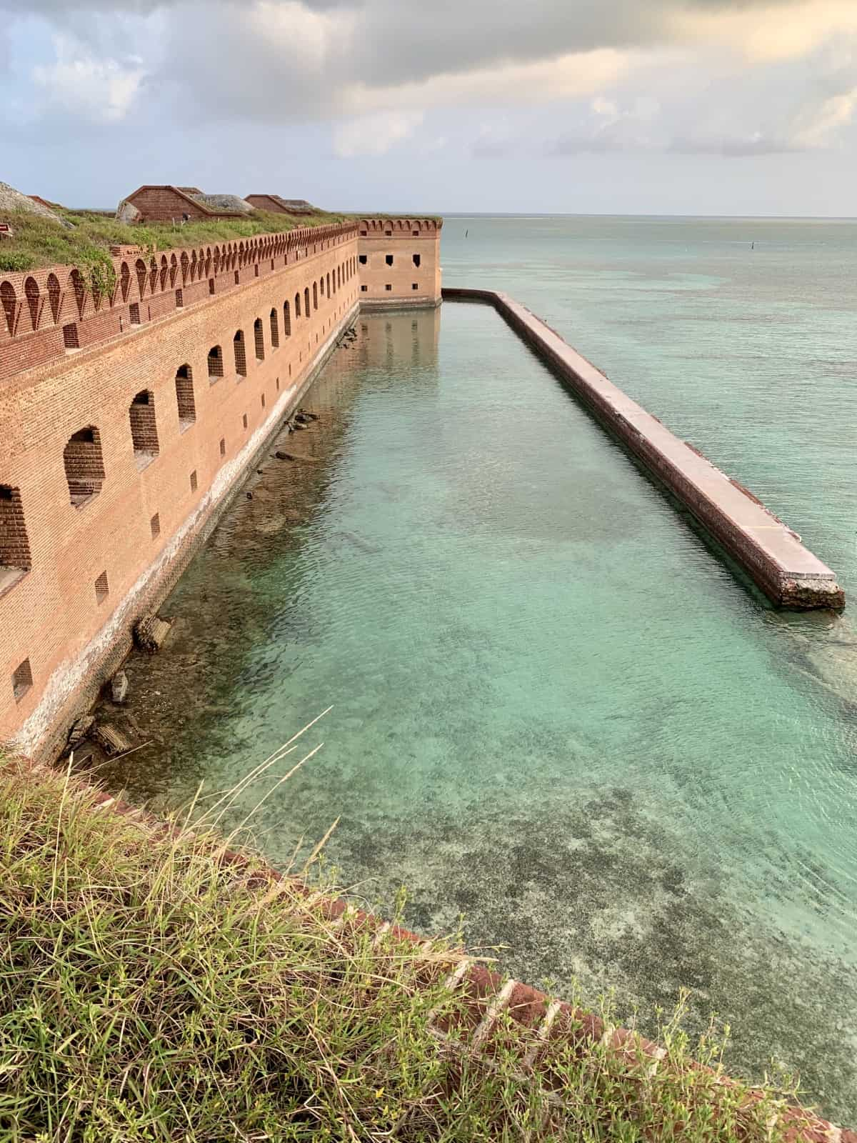 Exploring Fort Jefferson...Dry Tortugas National Park | Off the coast of Florida (70 miles west of Key West) sits this gorgeous tiny national park in the middle of the ocean, crowned with a historic masonry fort. What to expect when you visit Fort Jefferson, what to see, things to do at Dry Tortugas in the USA. From history to photography to bird watching to snorkeling, this is a must-do if you're visiting Key West. #florida #nps #drytortugas #nationalpark #fortjefferson